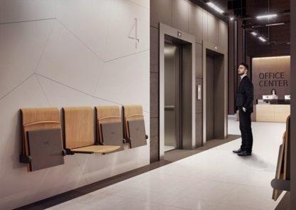 Elegant klapsæde til væg til venteområde. Fås også med avisholder. Nem siddemulighed og nem rengøring.