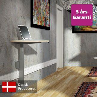 Billede af vægophængt hæve sænkebord, her med afstand til væg